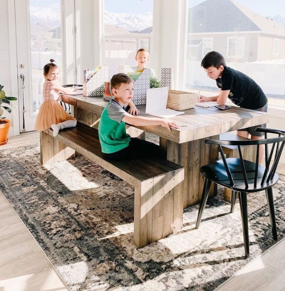 Right now, your kitchen table might have become a desk. Your coworkers might have become your children or spouse. It's important to remember that you're not alone! ❤️@ashleyrosereeves helps her children with their schoolwork, turning her kitchen table into a command center. The table sits on Newalla Arae Rug. #boutiquerugs #arearug #modernrugs #farmhousedecor #farmhousestyle #moderndecor #modernstyle #styleyourspace #homedesign #interiorstyle #modernhome #ourhome #ourcustomersrock #reviews