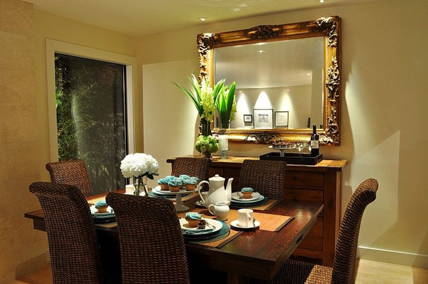 In this classic dining room, a hanging fixture might make the area feel more closed in. Instead, a few pin spots are used to highlight the modern buffet and ornate mirror. ➤ Discover the season's newest designs and inspirations. Visit us at http://www.wallmirrors.eu #wallmirrors #wallmirrorideas #uniquemirrors @WallMirrorsBlog