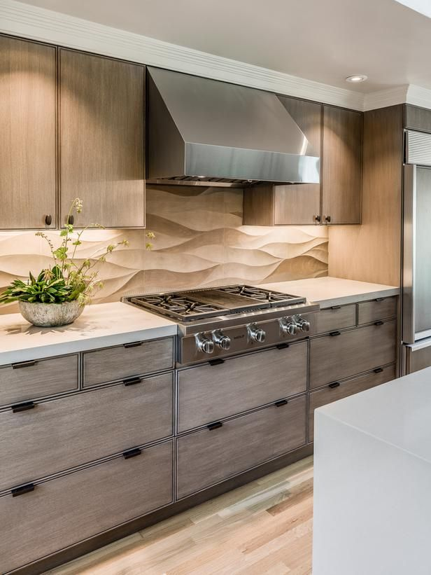 A Neutral Limestone Backsplash Contrasts The Straight Lines Of Wood Grain In Hardwood Floors