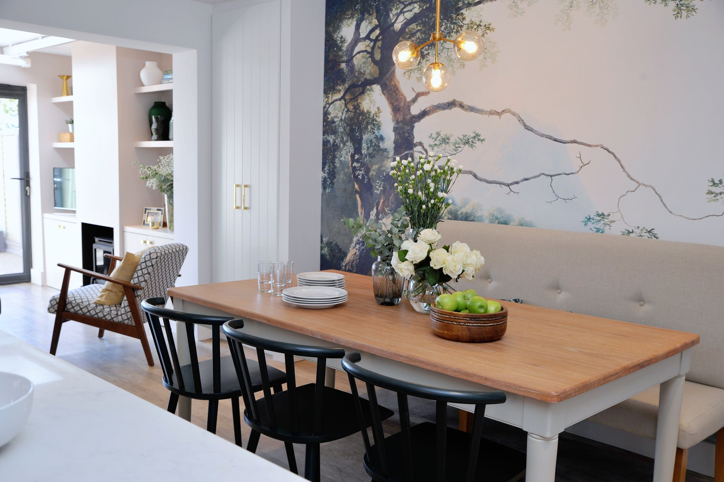Dining room with feature wall and upholstered bench. For