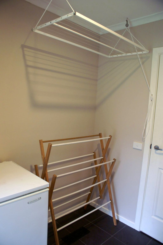 19 laundry room clothes hanger racks
