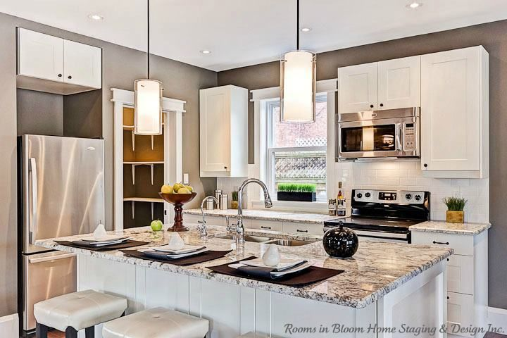 Tips For Kitchen Updates On A Budget. Get The Most Bling For Your Buck.  Lighting, Granite Highlight Counter And Laminate Elsewhere, Glass Insert  Cabinet ...
