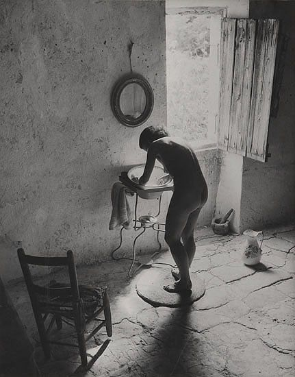 """""""We had a little stone cottage at Gordes. It was a hot summer, and I was repairing the attic. I needed a trowel, so I came down and there was Marie-Anne standing naked on the stone flags, washing herself from the tin basin. 'Don't move,' I said and, my hands full of plaster, I grabbed my Rolleiflex and took four shots. It was the second shot which I chose."""" -- Willy Ronis"""