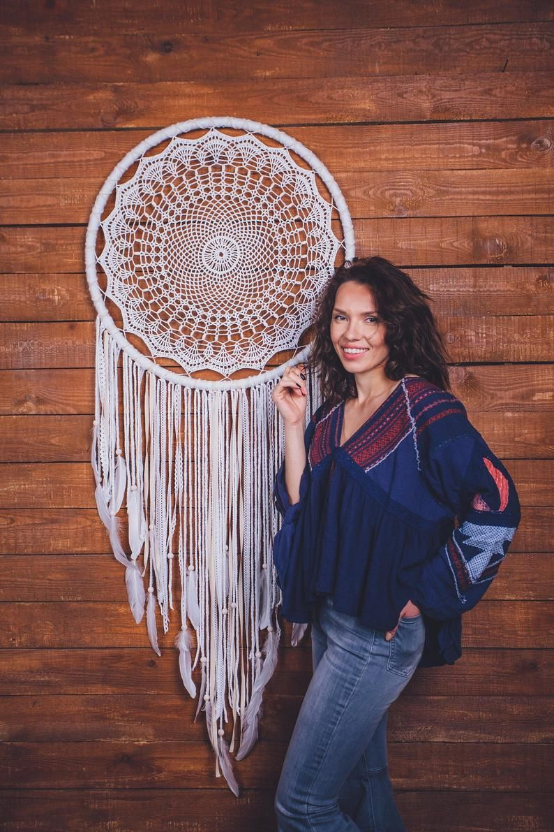 Would this giant doily dream catcher wall hanging melt your heart? Absolutely. This is a beautiful handcrafted boho wall art piece that will bring peace and serenity to your living room. Consider this large dream catcher, if are looking for a gift for a boho lover. Amazing wall art for a dream bohemian home. Pure beauty.  #dreamcatcher #dream catcher #bohodecor #bohohome #walldecorations