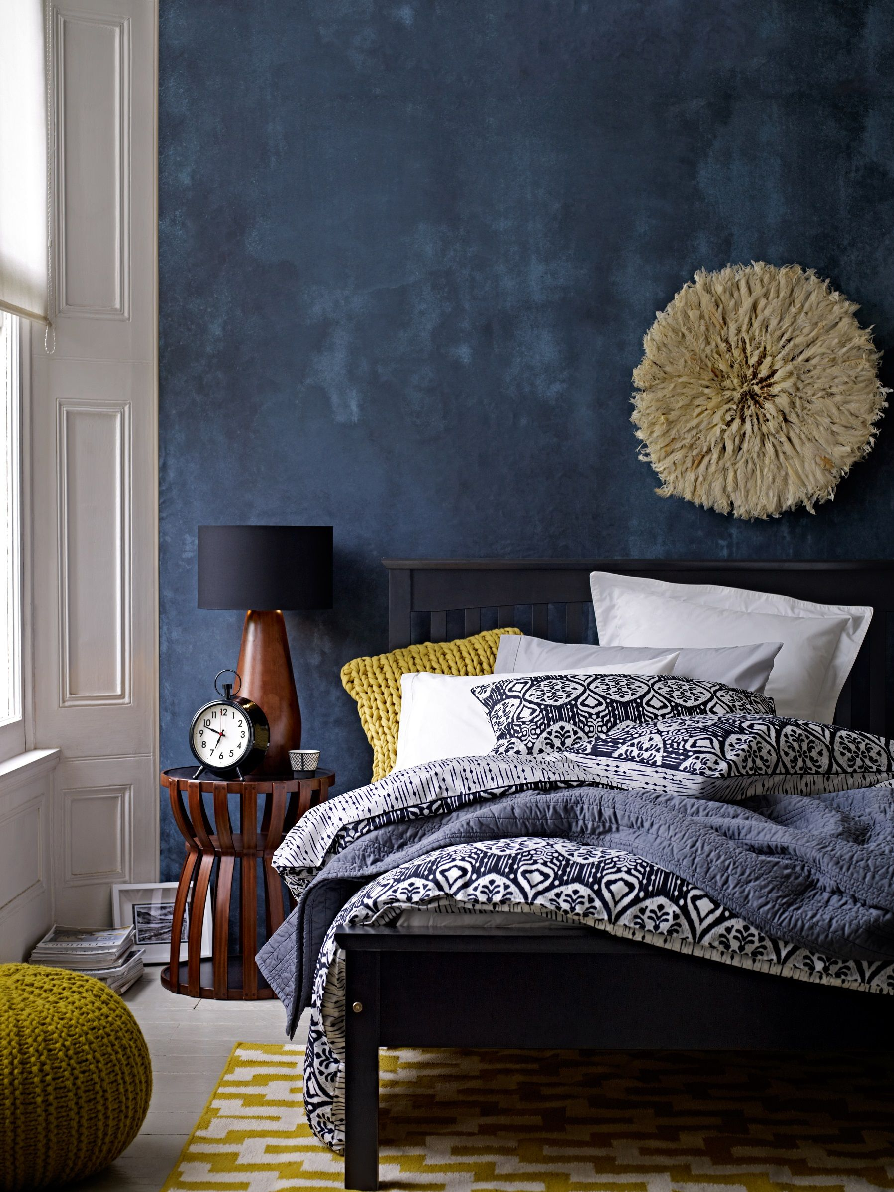 Deep blue accent wall in modern eclectic bedroom gorgeous use of color with wall and bedding