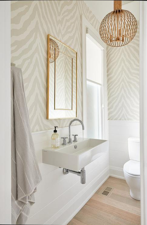 Light Airy And Updated Bathroom Boasts Gray Zebra Print Wallpaper And Shiplap Trim On Walls While In 2020 Half Bath Decor Zebra Print Wallpaper Powder Room Wallpaper