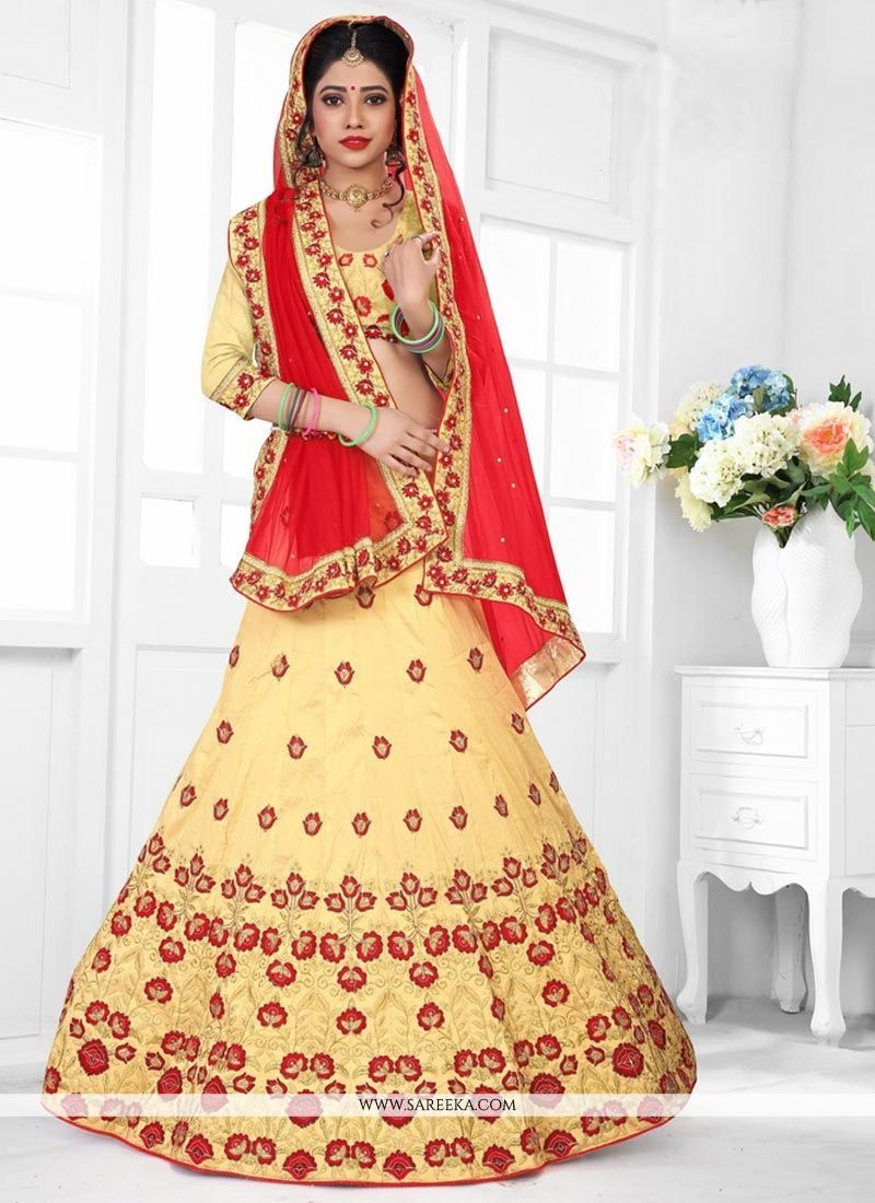e09d3cac4e Add a young burst of color to a wardrobe with this red and yellow art silk  lehenga choli. This pretty dress is showing some unbelievable embroidery  done ...