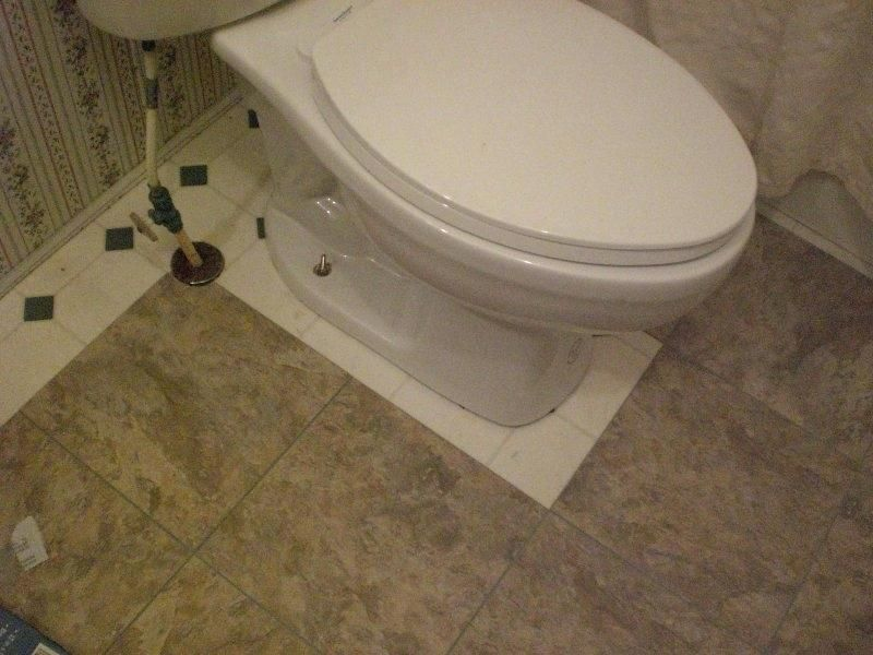 Installing Peel Stick Tile Under A Toilet Stick On Tiles Peel And Stick Tile Vinyl Plank Flooring Bathroom