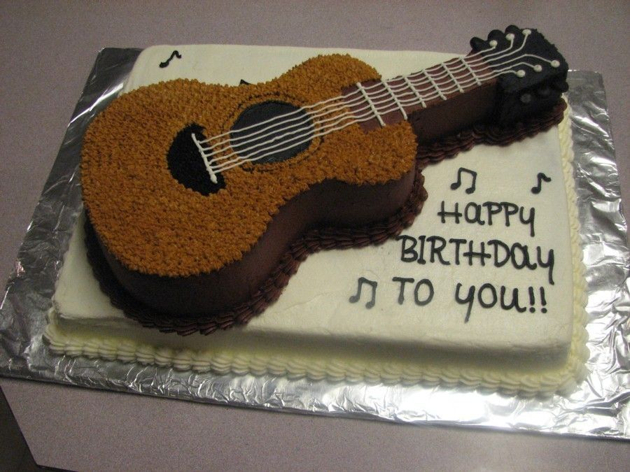 To crumb coat the birthday cake spread thin layer of guitar