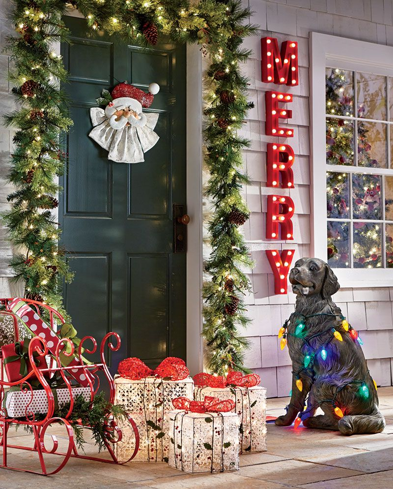 Wred In Greenery And Sprinkled With Lights Your Front Porch Will Offer A Gracious Holiday Welcome These Outdoor Christmas Decorating Ideas