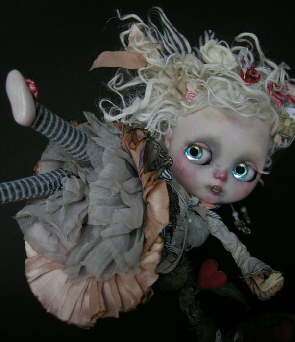 By Julien Martinez. That hair, those ruffles, and the eye chips!