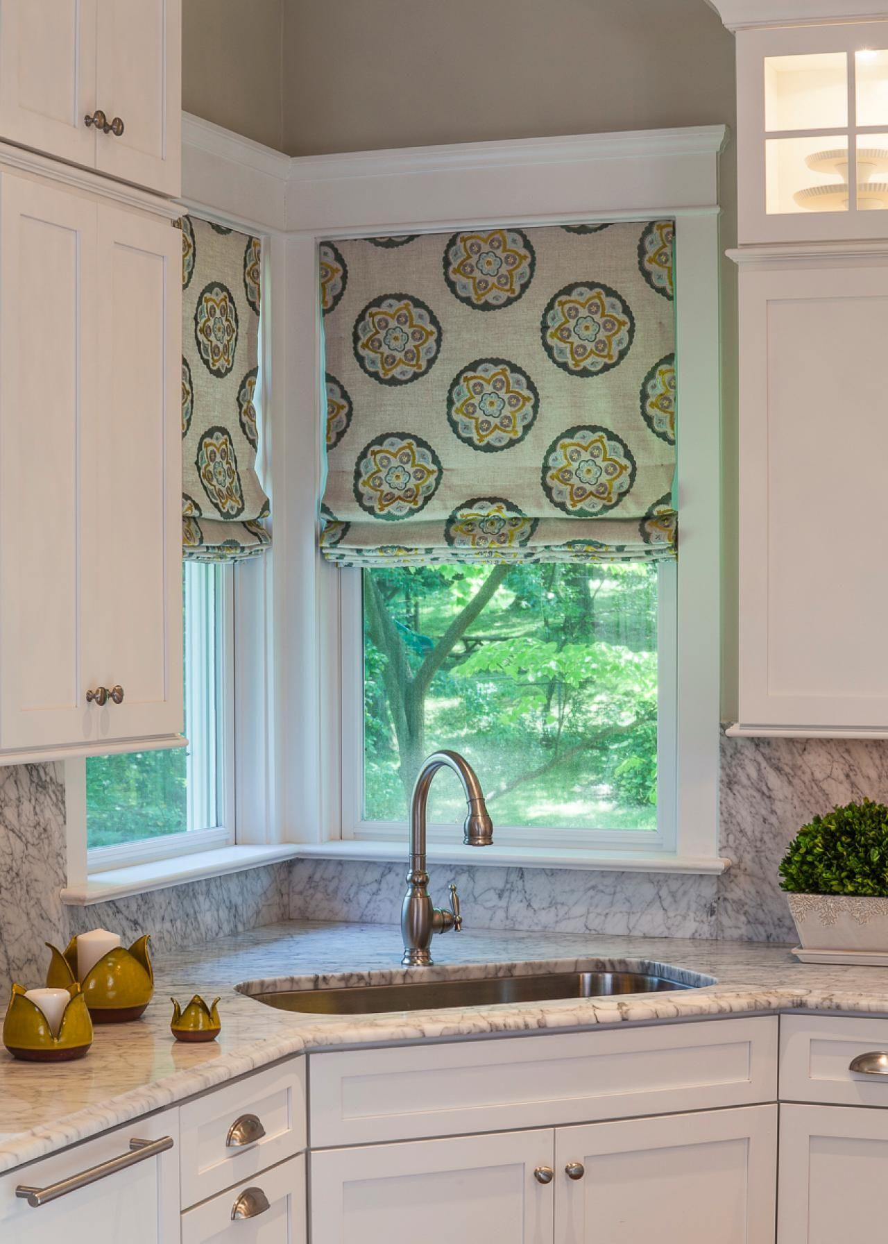 This transitional kitchen\'s corner has a beautiful view and is a ...