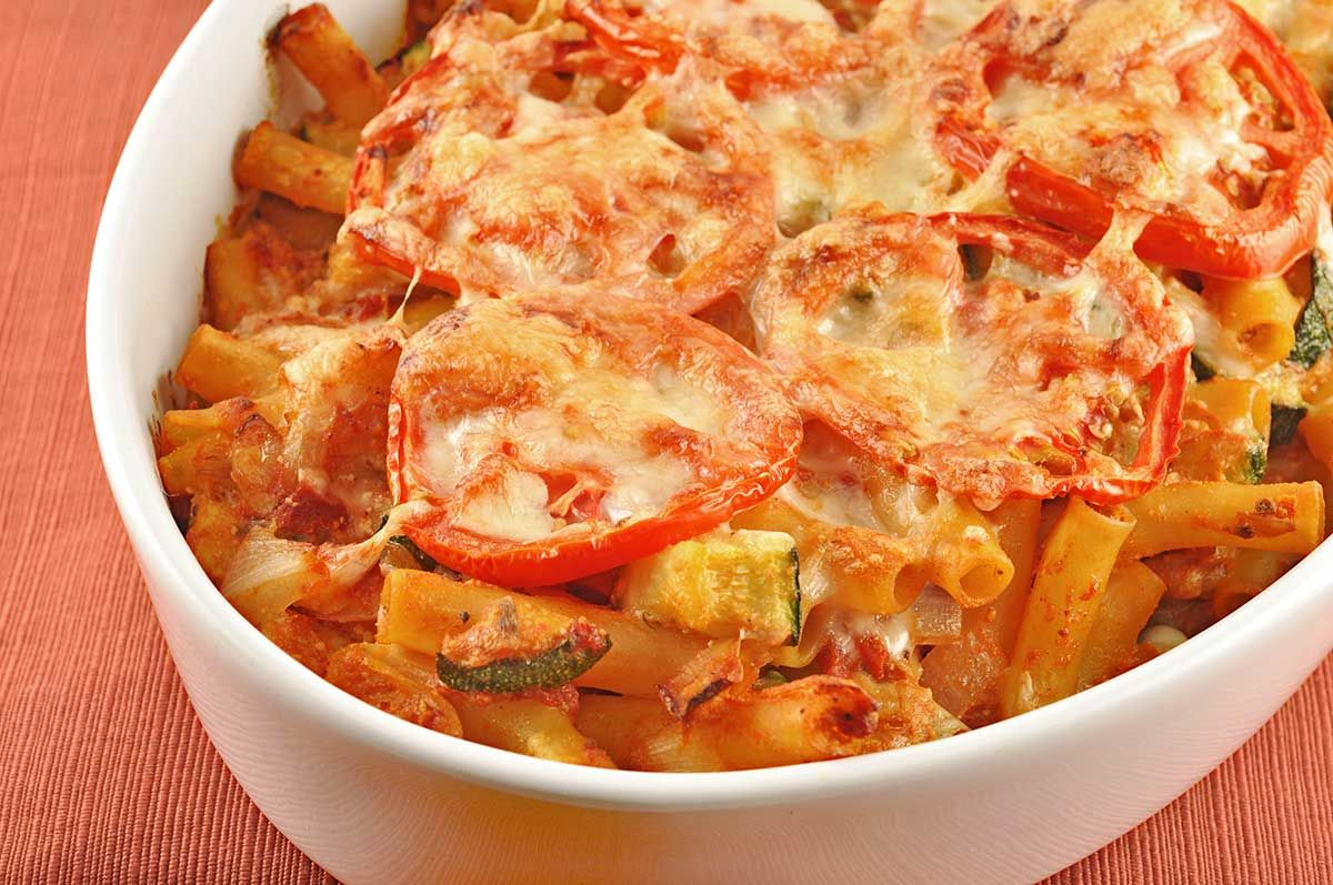 Baked Ziti with Zucchini, Artichokes and Pancetta: Our version of baked ziti uses zucchini, artichokes, pancetta and some fresh tomato for an easy twist on the classic dish.