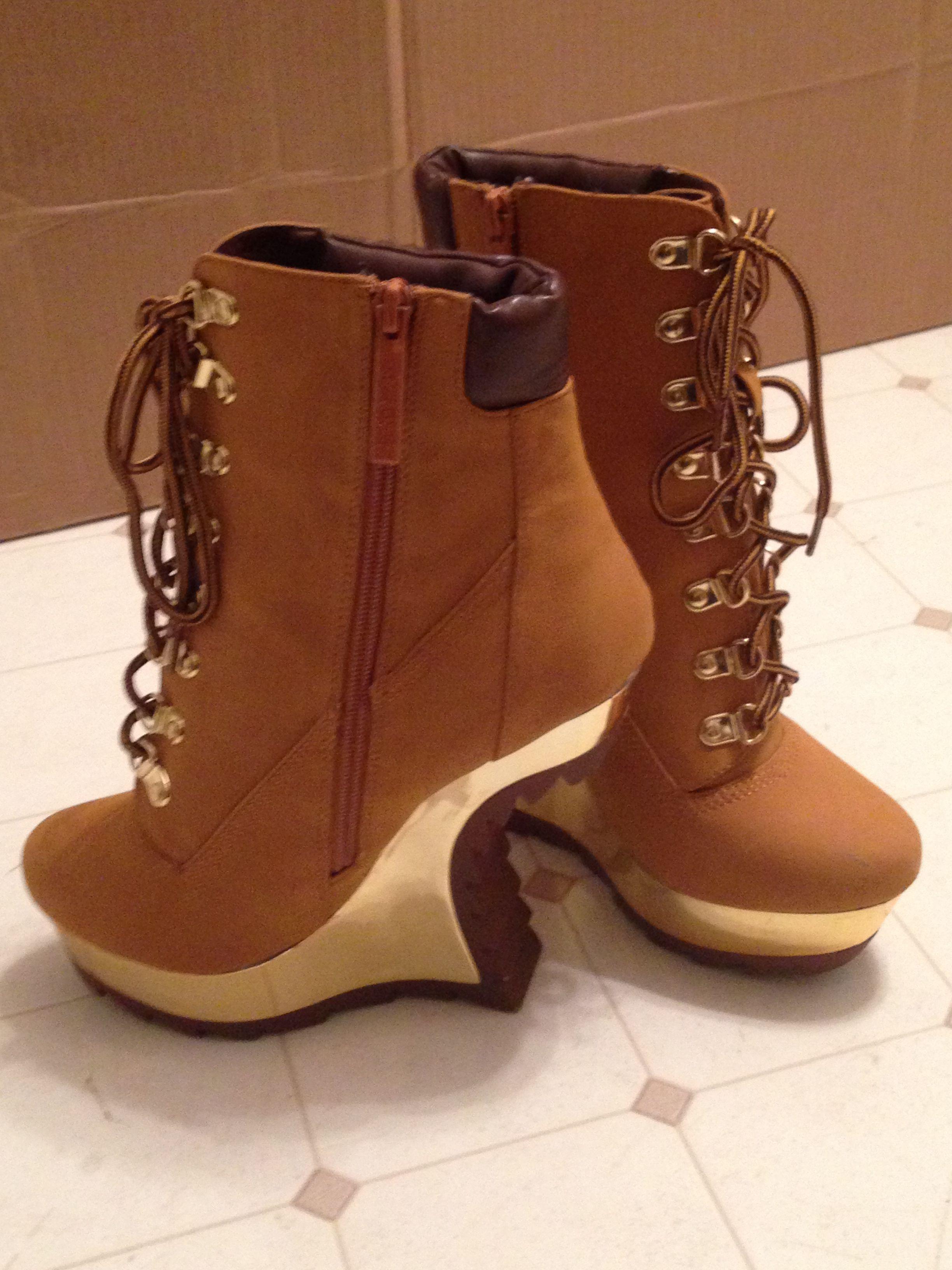 Alba Bond's Timberland inspired heel-less heel booties. Tan laceup heeless  gold mirrored platform