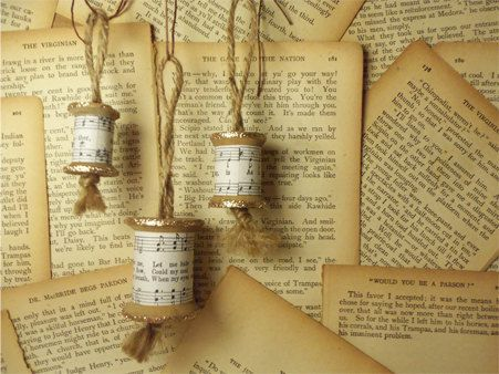 Ornaments made from wooden spools wrapped in vintage sheet music... made by me :)