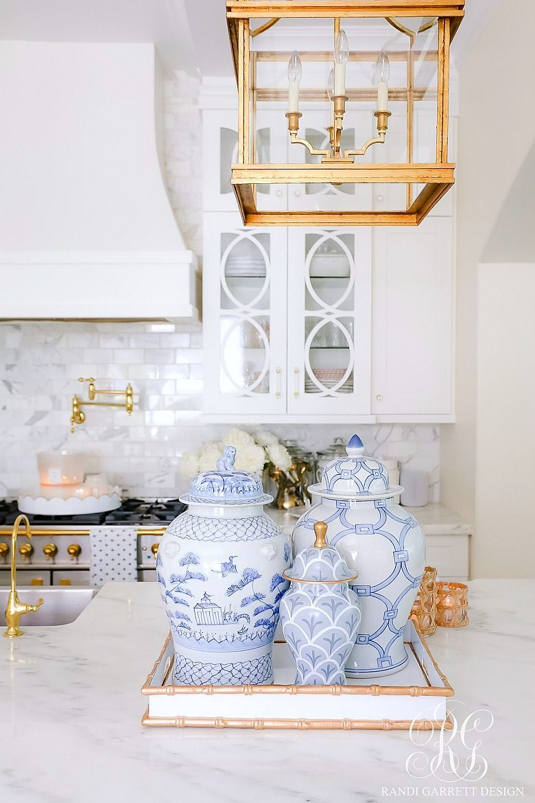 blue ginger jars gold accents #whitekitchen #chinoisserie #kitchendecor #gingerjars #summerdecor #bluerug #bluegingerjar #whitedecor #kitchen #goldlantern #transitionaldecor #lightandairydecor