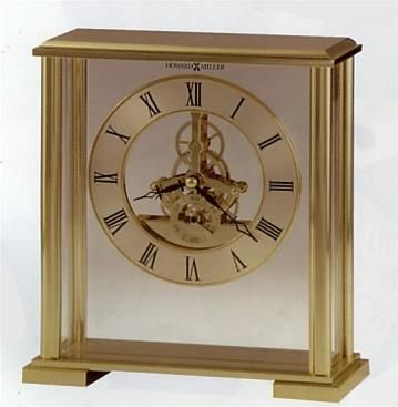 Howard Miller Fairview Table Top Clock. h1Howard Miller Fairview Table Top Clock_h1The Howard Miller Fairview Table Top Clock has a polished brass finished skeleton movement that is suspended by a clear acrylic panel between the front and back glass, so as to a.. . See More Table Clocks at http://www.ourgreatshop.com/Table-Clocks-C1125.aspx