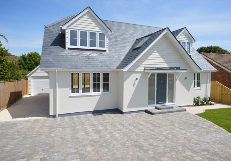 Like the roof colour, render and porch here, Plus cladding