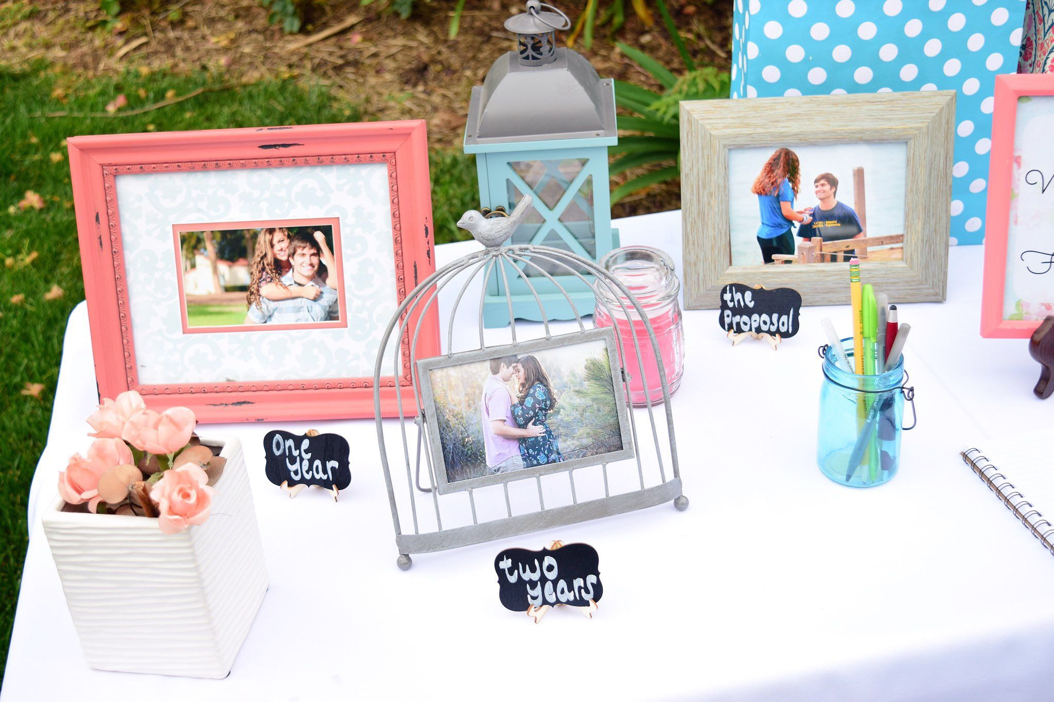 Decorate your engagement party sign in table and gift table with ...