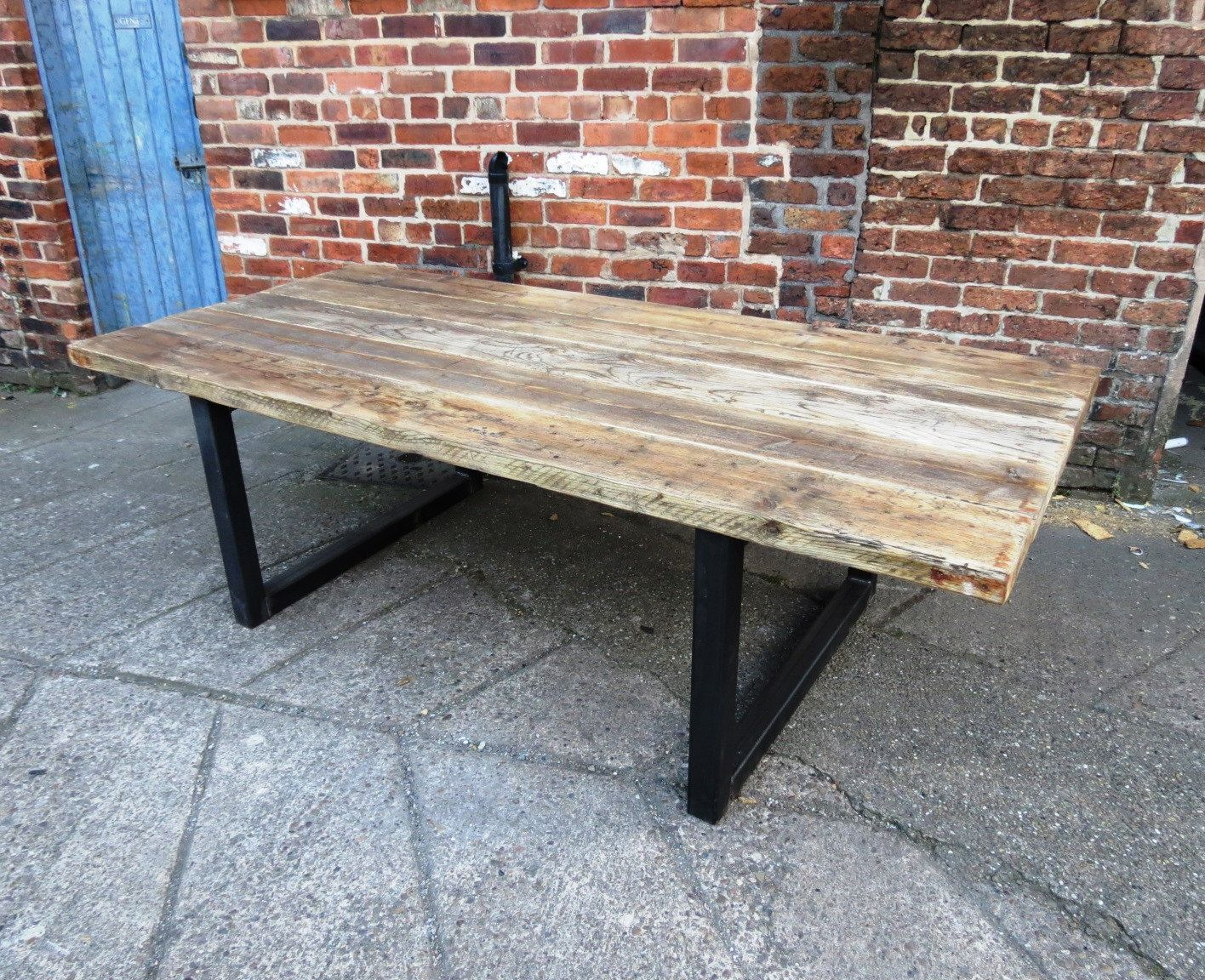 Here is our seater dining table made from reclaimed timber and