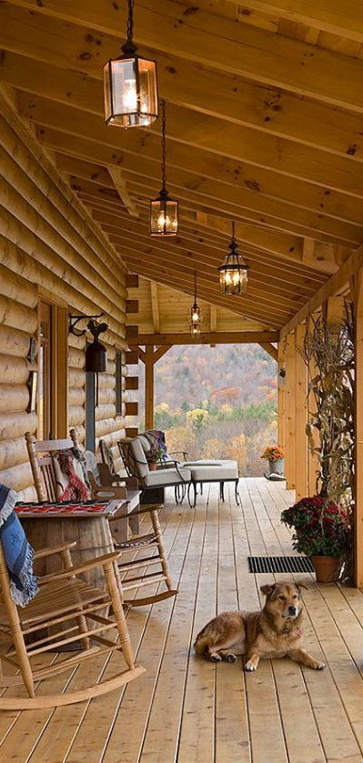 I Would Love To Sit On The Front Porch With My Dog In A Rocking Chair With Mountains For A View Rustic Porch Log Homes Log Home Living