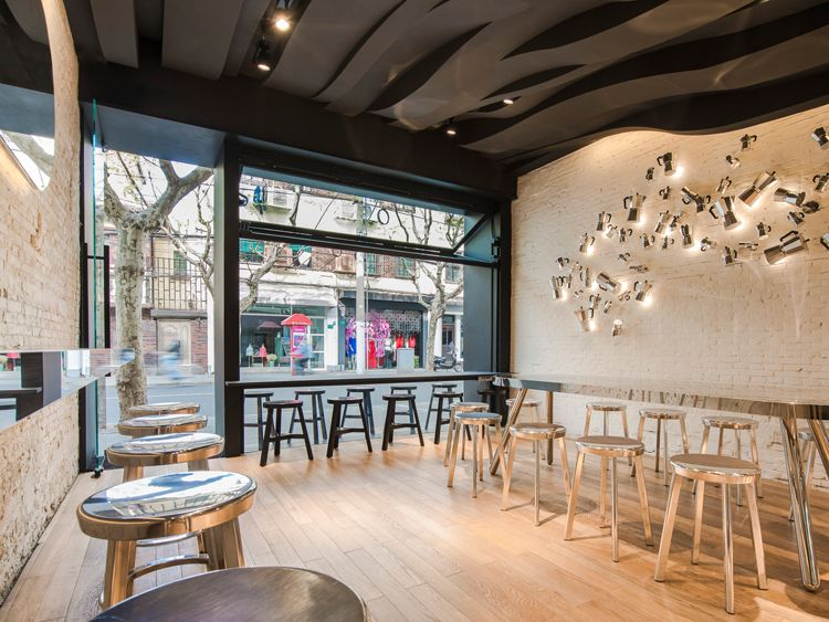 Celebrating coffee's intangible pleasures, Alberto Caiola translates coffee's aromatic vapors into a sculptural ceiling that is the centrepiece for this café in Shanghai.