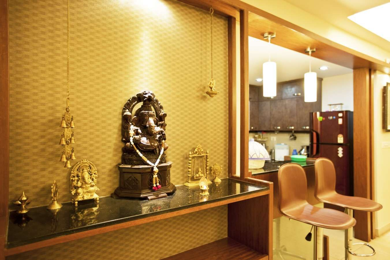 Divine space pooja unit with golden wallpaper home for Divine interior designs