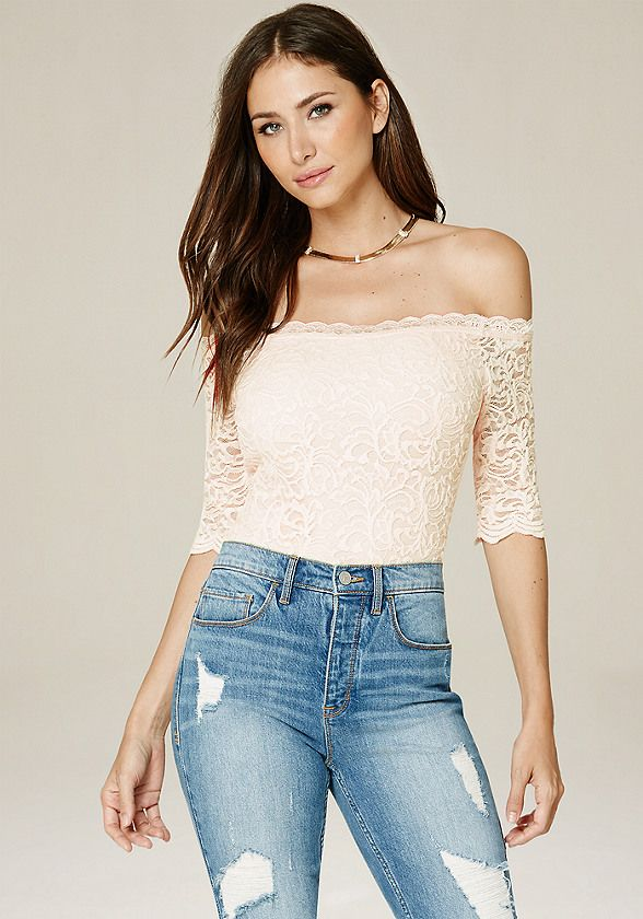 Sultry lace bodysuit in an off-shoulder design. Elbow sleeves. Scalloped edges. Snap panty closure. Partially lined.