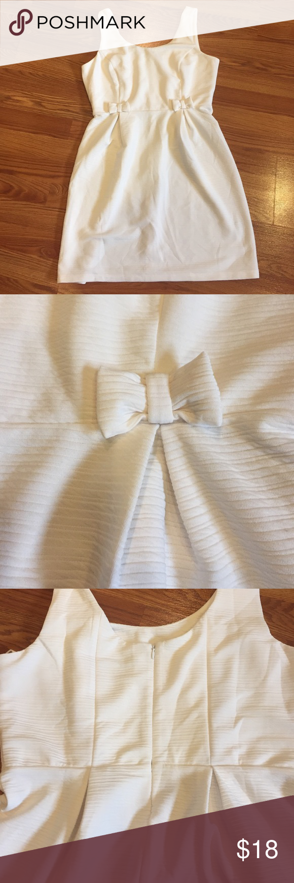 LC Lauren Conrad Dress Adorable LC cream dress with little bow detail on the front. Zipper back. Size 16. Worn once. LC Lauren Conrad Dresses Wedding