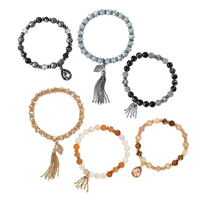 Nadia Stretch Bracelet Set | The Nadia Collection features layers of multi-textured beads alternating with faceted and metallic accents. FEATURES • Set of 3 stretch bracelets with a mixture of glass, metal, and plastic beads in various shades of gray/black or champagne/cream • Each bracelet has a charm: teardrop faceted stone, longer multiple chains with a feather and short cluster of chains • Bracele... ~ Avon Rep Beth Bailey ~ Avon eStore LipstickShoesAndMore.com
