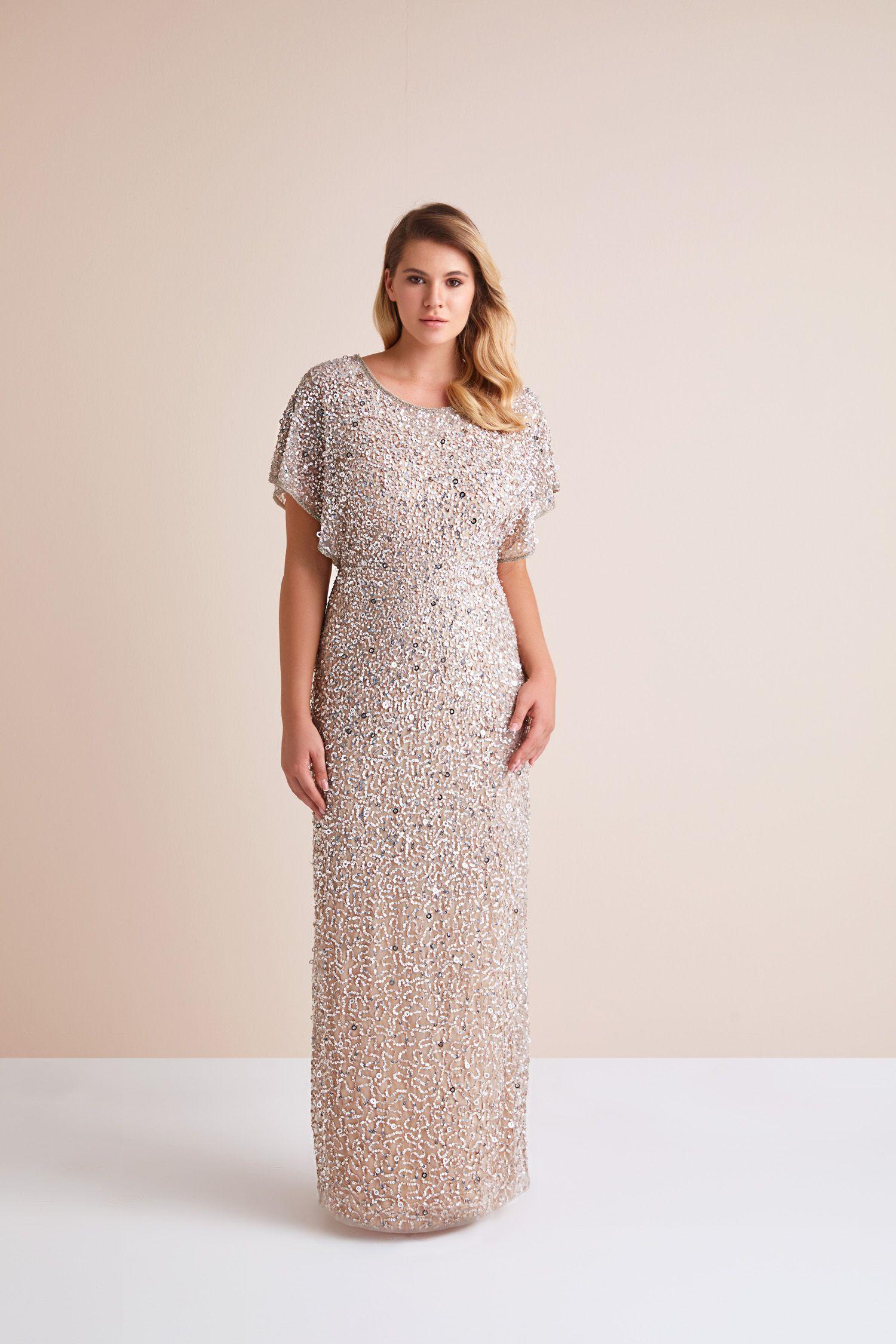 10490f7faa1a2 Gümüş Rengi Kısa Kollu Payetli Uzun Abiye Elbise. En şık Büyük Beden Abiye  modellerini Oleg
