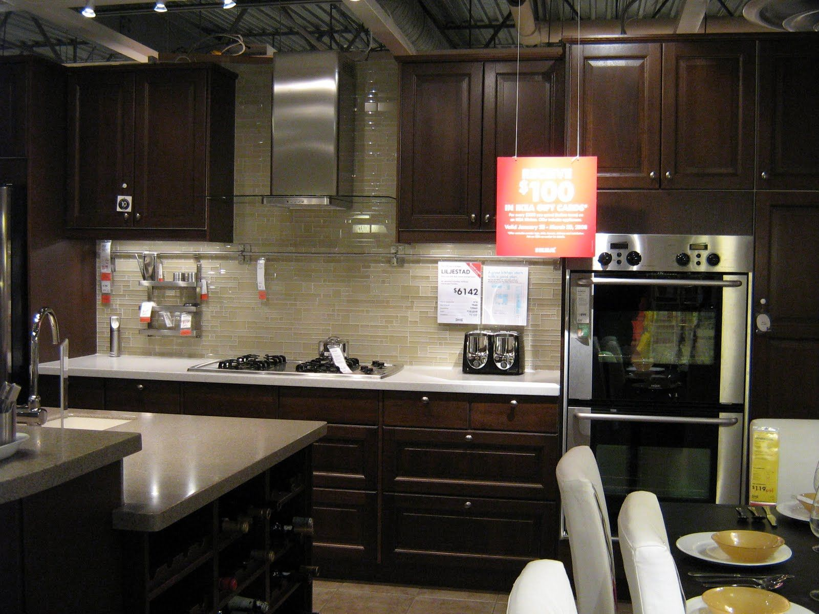 pictures of ikea kitchens dark wood cabinets and light sand tones glass tile backsplash - Ikea Black Kitchen Cabinets