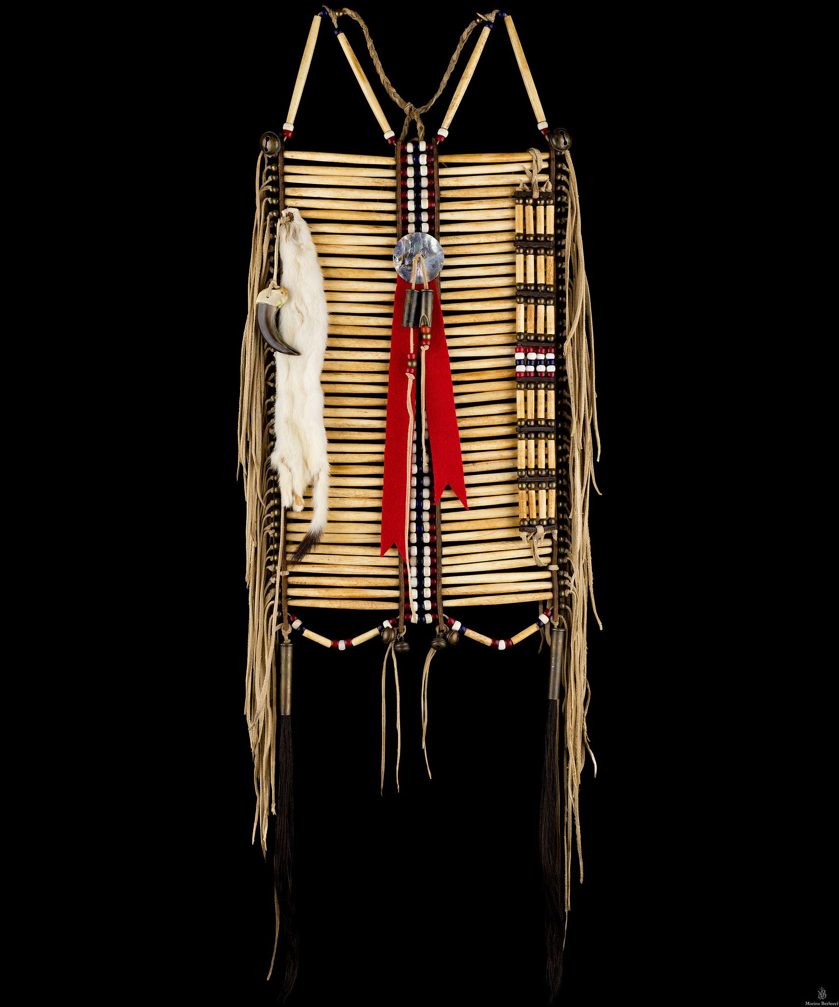 """Pony soldier hairpipe breastplate & choker set  Museum quality reproduction of a 1870-s Lakota warrior bone hair pipe breastplate. Hand selected 4"""" genuine bone hairpipe (antiqued), brain tan deer leather fringes and ties (antiqued), brass beads and glass (antiqued), saddle leather spacers."""