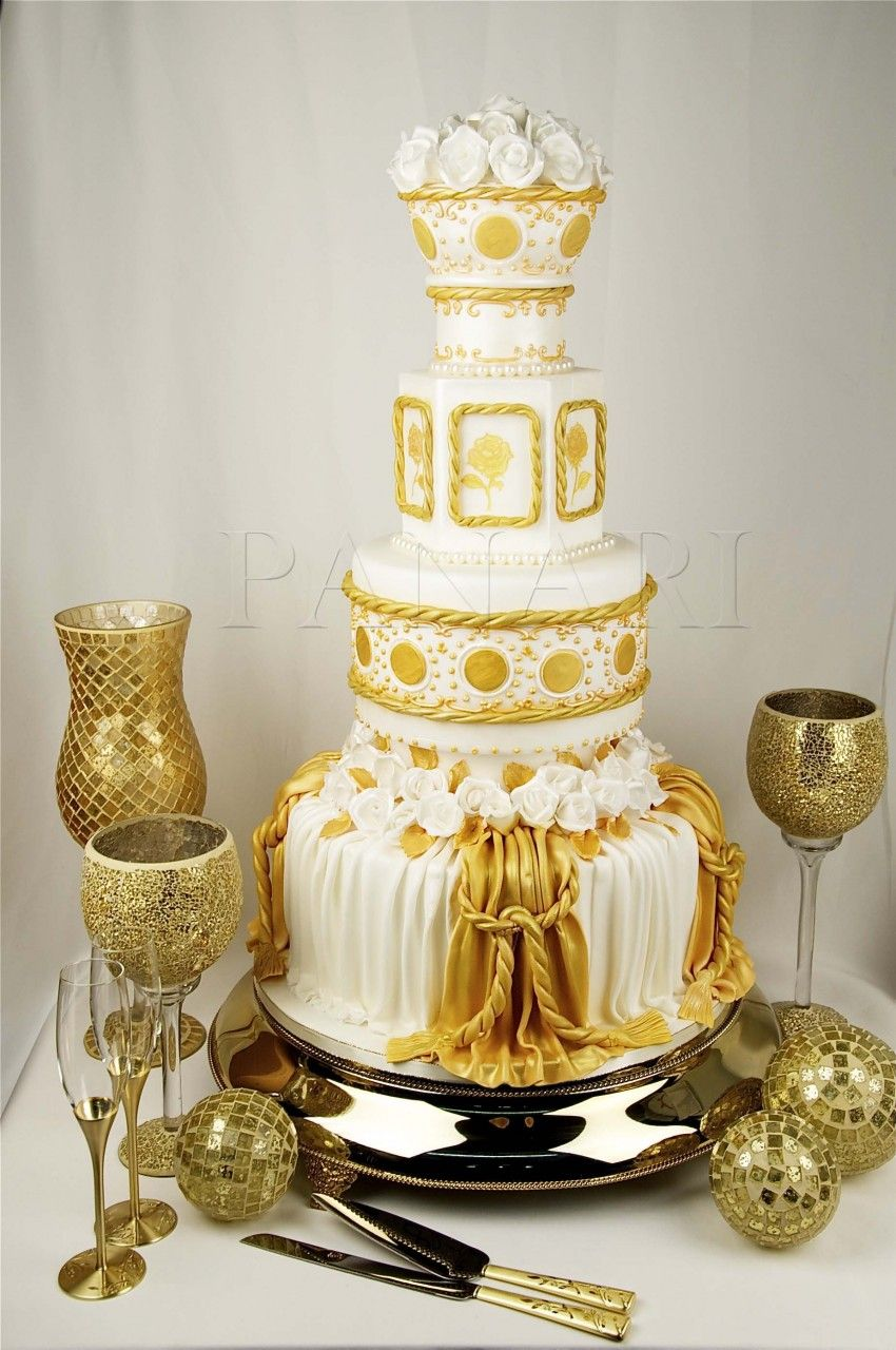 Ivory and gold wedding cake - very exotic I think. Love the gold ...
