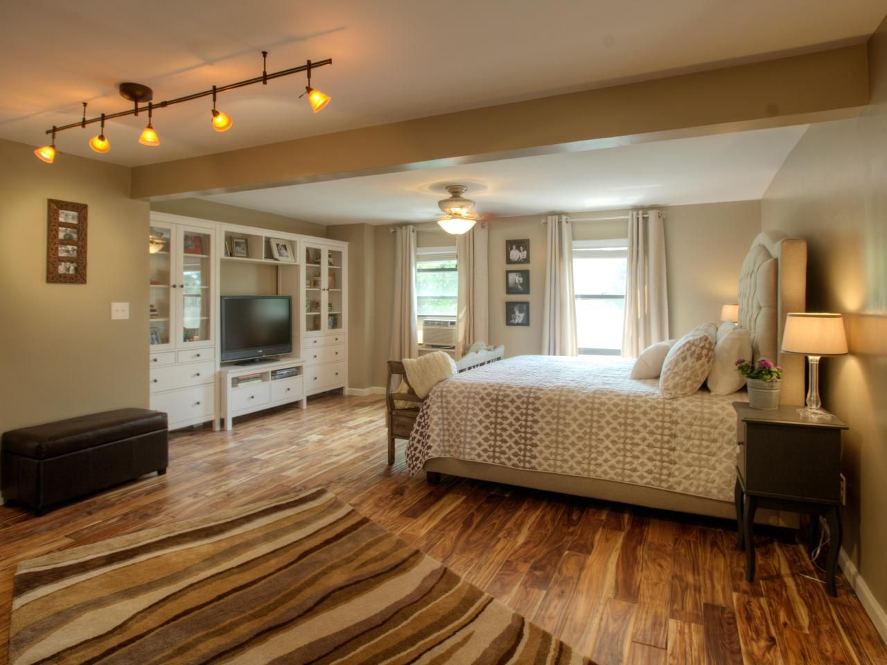 neutral transitional bedroom with hand-scraped wood floors