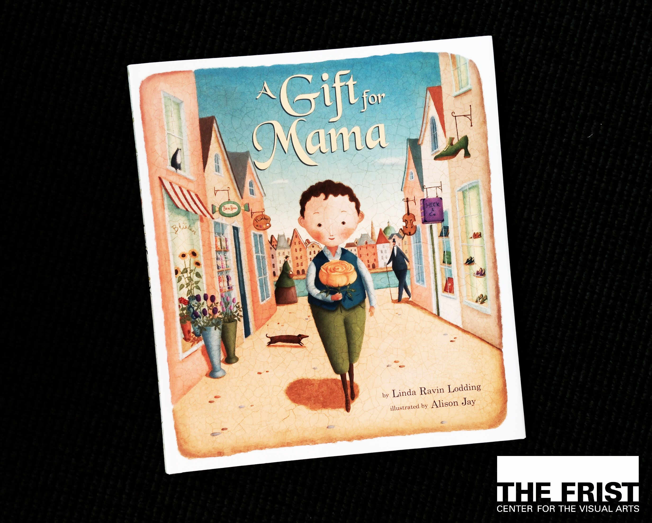 Accompany Oskar through the bustling streets of Vienna as he searches for the perfect birthday present for his Mama. What will he choose, a flower, a paint brush, some sheet music? Follow Oskar as he meets new and interesting people who help him find the best birthday gift possible. Simple kindness is the theme of this children's book, available in the Frist Center's gift shop to accompany our exhibition, Wiener Werkstätte.