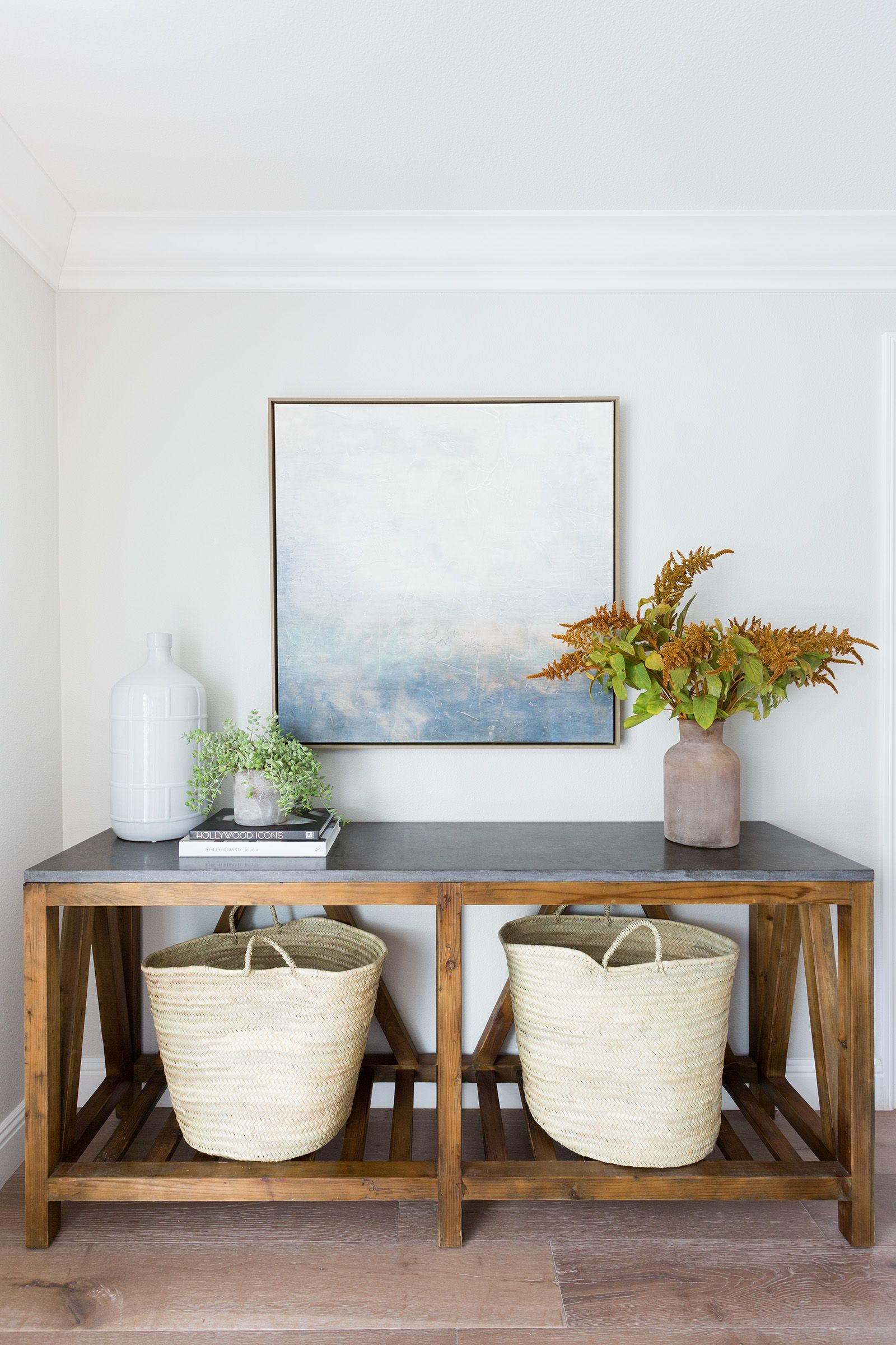 Entryway Table Styling Baskets Under The Console Table Blue Abstract Art Lindsey Brooke Des Console Table Styling Entryway Table Styling Foyer Decorating