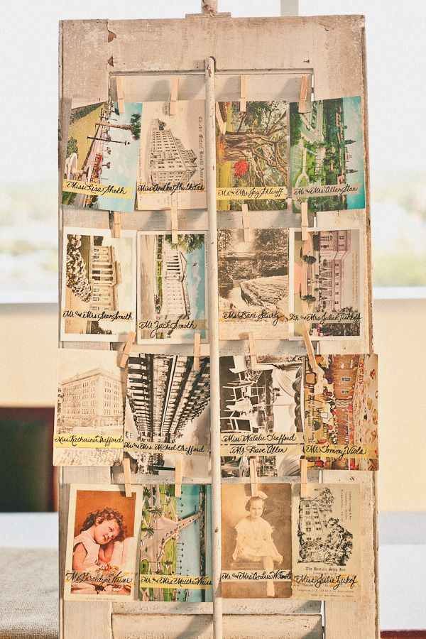 vintage postcards on shutters for the ultimate vintage seating arrangement cards