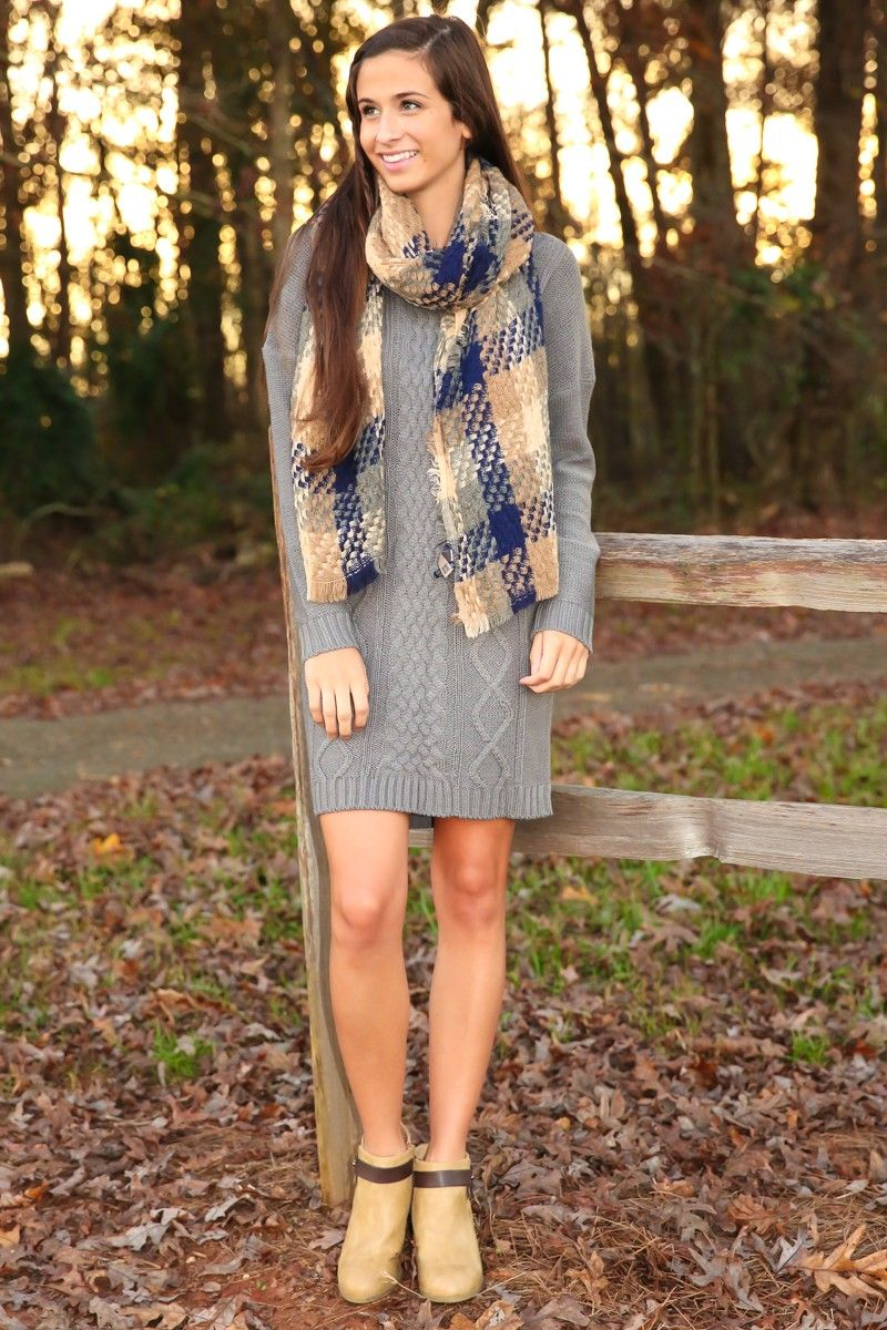 """If you have to be """"Stuck In Colder Weather"""" make the time a lot more chic with this sweater dress! Keeping you warm and looking hot may be just what the weather ordered to find yourself freed from the clutches of old-man winter and hopefully into the arms of someone a lot younger and bringing the heat your way!! Open knit sweater dress with long sleeves and a scoop neckline. Unlined. 100% Acrylic. Wash by hand in cold water separately or dry clean. Lay flat to dry. Iron low if needed. Do…"""