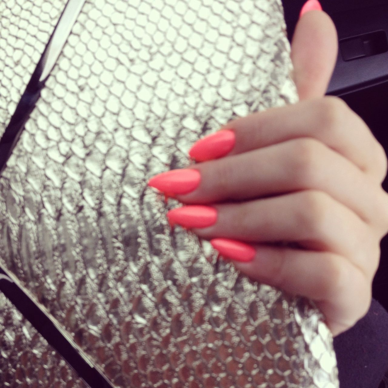 Obsessed with the coral nails, but the stiletto nails will take a while to get used to.