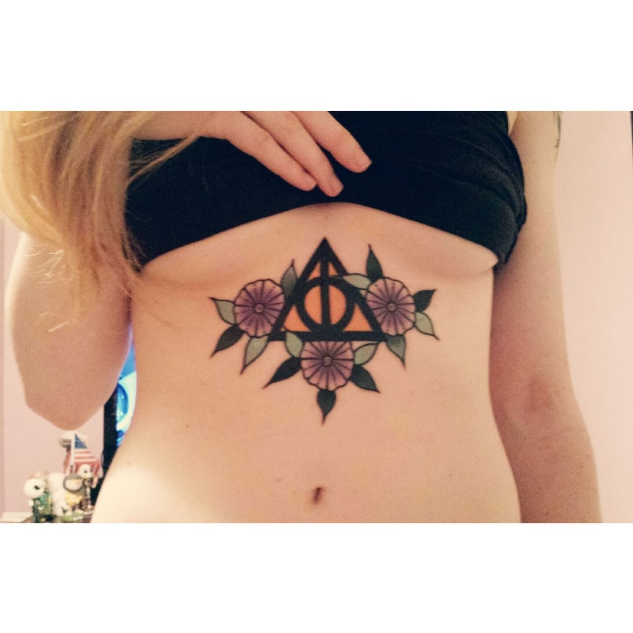 Really love the idea, but I think the deathly hallows mark could be more elegant. I'm also not a big fan of the combination of colors.
