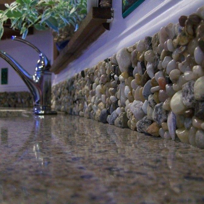 Mandolin Mosaics: mosaic backsplash, including stones and shells brought back from travels.
