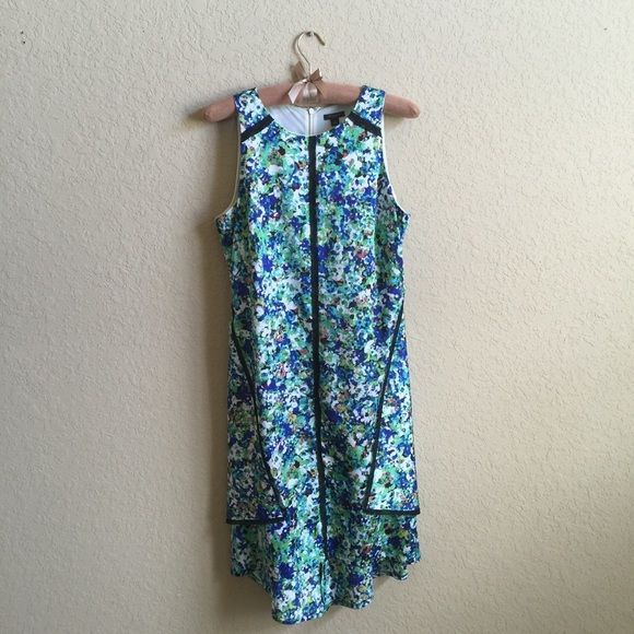 Ann Taylor Floral Silk Dress Beautiful floral silk dress. I LOVE this dress. It gorgeous on and really flattering. Ann Taylor Dresses High Low