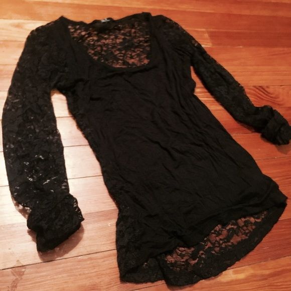 Black forever 21 lace Shirt Stretchy blck forever 21 lace long sleeve shirt.  Lace fully in the back and sleeve. The front is solid black.  Cute with shorts or jeans Forever 21 Tops Tees - Long Sleeve