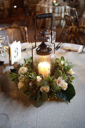 For Tables With Lanterns, Idea for how To incorporate floral arrangements.