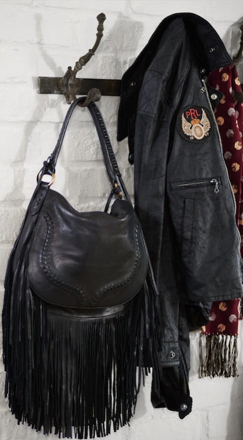 61a3207e94 Finishing Touches  The Polo Ralph Lauren black fringed leather saddle bag  instantly elevates any fall ensemble. Spacious enough for all of your daily  ...
