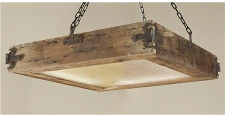 Railroad tie/reclaimed wood chandelier.  I could see this over an island in a rustic kitchen.