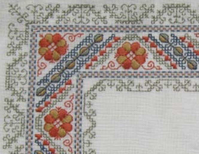 The patterns on this Latvian mat are taken from original Latvian designs and stitched in traditional colours. Stitches used are satin and double running stitches. The piece is stitched on 30 count linen.