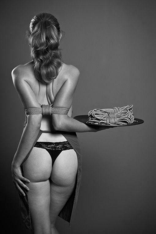 Restraining a submissive with rope bondage