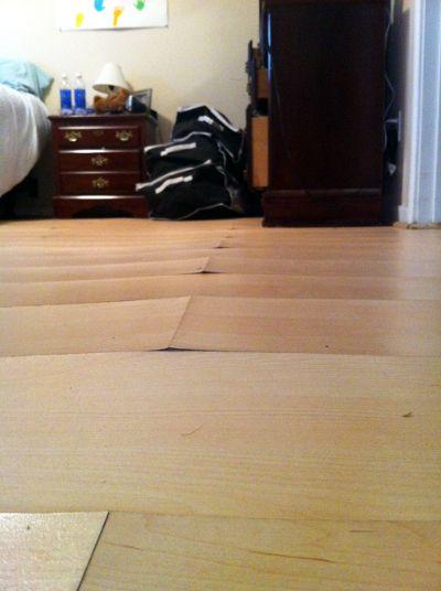 Laminate Floor Water Damage Mid Lease Replacement Rental